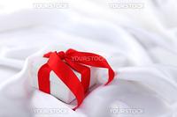 christmas gift on white silk background