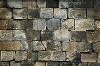 Old stone wall, flat stacked background and texture.
