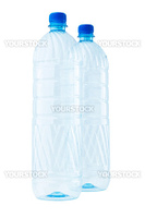Two empty plastic bottles isolated on white.