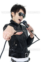 Asian rock singer in performance, isolated on white