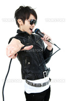 Asian rock singer in performance, isolated on white, focus on fingers.