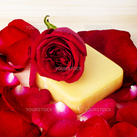 Red rose and soap. Bathroom or wellness background.