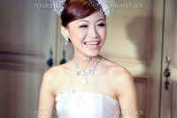 Beautiful Asian bride is smiling.