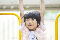 Asian girl playing in park