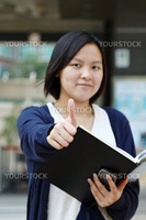 Asian woman thumbs up