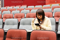 Asian student studying in lecture hall