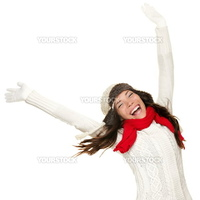 Winter fun woman winner and success concept. Cheering happy ecstatic female model with arms up celebrating winning something. Multicultural Caucasian Asian winter girl isolated on white background.