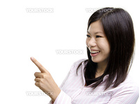 Asian pointing to empty space, ready for text.