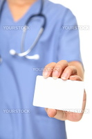 Nurse business card sign closeup. Female doctor or nurse holding and showing blank empty business card on white background.