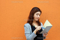 Asian woman reading and studying