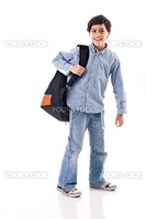 School boy using a backpack
