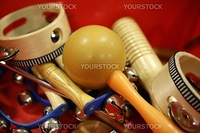 mixed percussion toy instruments over red background