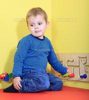 Cute european toddler in kindergarten.