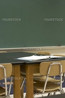 a picture of desks and chalkboard in school classroom