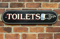A hand-painted sign, in Victorian style on a red brick background. Clipping path included so the sign can be isolated and placed on any other background.