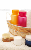Spa settings with flower, shampoo, candle and towel