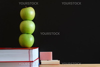 blank blackboard with apple and books and text space