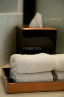 pile of towels in a hotel bathroom, shallow DOF
