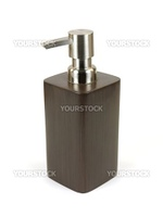 A soap dispenser isolated against a white background