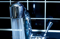 Modern Faucet with running water in blue