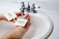 A person washing germs and bacteria off of theit hands.