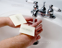 A person washing germs and bacteria of of their hands.