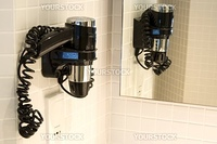 Image of a hair dryer in a bathroom.