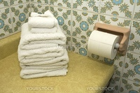 bathroom still-life, white towels and toilet paper,