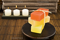 Soap candles and towels in a spa - shallow depth of field