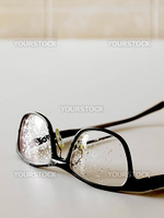 close up of wet eye glasses in bathroom