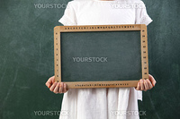 stock image of girl holding a blank balckboard