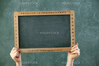 hand lifting tha blank black board