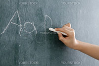 stock image of the little girl writting abc