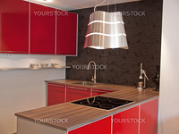Modern design red kitchen with wooden counter