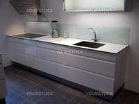 Modern design trendy kitchen with white wood elements, metal and glass