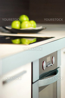 Granny smith apples on table in modern kitchen