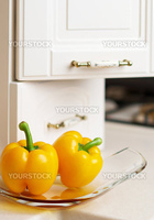 Yellow sweet pepper on white kitchen's table