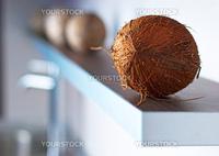 Brown coconuts on modern white kitchen