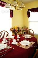 A small kitchen table set for a meal