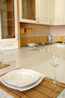 details of plate and glass in modern kitchen