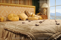 luxurious bed in a number with a kind on mountains