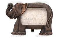 Stand for photo in the manner of wooden elephant with paperboard inwardly, insulated on white background