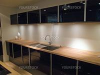 Modern clean design trendy kitchen with black wooden elements