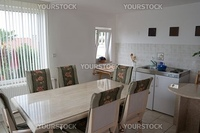 Kitchen and dining room with white walls