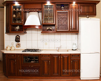 Modern kitchen an interior with ム災シミクムひーム・クミオミケ wood of valuable breeds and the built in illumination