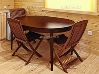 dining table as a part of kitchen interior in a wooden blockhouse