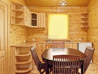 interior of the kitchen in a wooden blockhouse