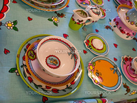 Country style dining room table arranged with traditional hand painted dishes