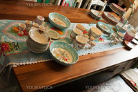 Country styl dining room table arranged with taditional dishes