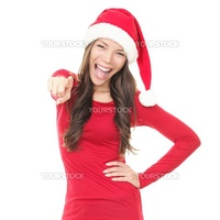 Woman in santa hat excited for Christmas. Surprised asian beautiful happy girl pointing at camera isolated on white background.